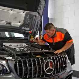 Common Roadworthy Fails Aaron checking for faults